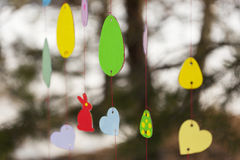 Decorative paper garland with colorful Easter egg sand  animal figurines. Decorative paper garland with colorful - yallow, red, green, blue, violet - Easter eggs Stock Photo