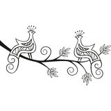 2 decorative paradise birds in a tree. Two decorative paradise birds sitting on a flourishing tree branch Royalty Free Stock Image