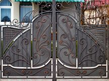 Decorative parts of metal gates, elements of hand forging.  Royalty Free Stock Photo