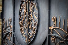Decorative parts of metal gates, elements of hand forging.  Stock Image