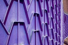Decorative parts of metal gates. Metal purple fence. Texture of. Old metal background. Geometric pattern Concept: creative Royalty Free Stock Image