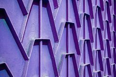 Decorative parts of metal gates. Metal purple fence. Texture of. Old metal background. Geometric pattern Concept: creative Royalty Free Stock Photography
