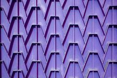 Decorative parts of metal gates. Metal purple fence. Texture of. Old metal background. Geometric pattern Concept: creative Royalty Free Stock Photo