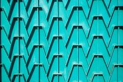 Decorative parts of metal gates. Metal turquois fence. Texture o. F old metal background. Geometric pattern Concept: creative Stock Photo