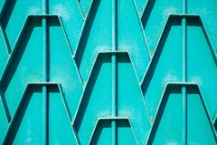 Decorative parts of metal gates. Metal turquois fence. Texture o. F old metal background. Geometric pattern Concept: creative Royalty Free Stock Images