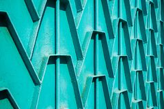 Decorative parts of metal gates. Metal turquois fence. Texture o. F old metal background. Geometric pattern Concept: creative Stock Image