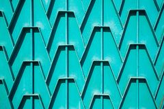 Decorative parts of metal gates. Metal turquois fence. Texture o. F old metal background. Geometric pattern Concept: creative Royalty Free Stock Photography