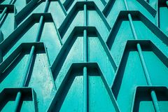 Decorative parts of metal gates. Metal turquois fence. Texture o. F old metal background. Geometric pattern Concept: creative Royalty Free Stock Photo