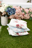 Decorative patterned pillows on the grass Royalty Free Stock Photos
