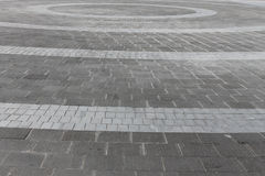 Decorative paving background. Background of decorative gray paving in circular pattern Royalty Free Stock Photo