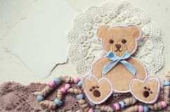 Decorative photo collage in vintage style with teddy bear and textile elements. Can be used as a template for congratulations on the birth of a child, birthday Royalty Free Stock Images