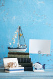 Decorative photo and marine items on wooden background. Royalty Free Stock Images