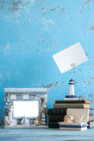 Decorative photo and marine items on wooden background. Royalty Free Stock Photography