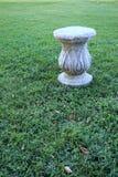 Decorative pillar over the grass. stock photo