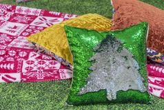 Decorative pillow with Christmas tree from sequins royalty free stock photo