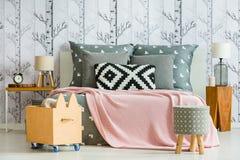 Decorative pillow in feminine bedroom Stock Photos