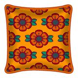 Decorative pillow. Interior design element: Decorative pillow with patterned pillowcase (abstract flowers pattern on bright orange background). Isolated on white Stock Images