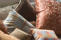 Decorative pillows. Multi colored decorative ornate pillows Stock Photo