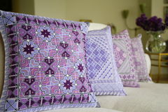 Decorative pillows. Blue and purple decorative pillows in a bedroom Stock Image
