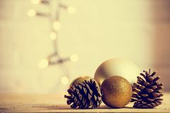 Decorative pine cones with gold christmas balls decoration Christmas background texture royalty free stock photos