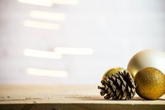 Decorative pine cones with gold christmas balls decoration Christmas background texture stock photography