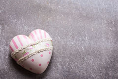 Decorative pink heart on grey  background. Royalty Free Stock Images