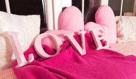Decorative pink letters forming word LOVE with pink pillows Stock Image