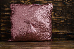 Decorative Pink Pillow  on Brown Wooden Background Royalty Free Stock Photo