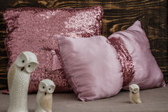 Decorative Pink Pillows  on Brown Wooden Background Stock Photos