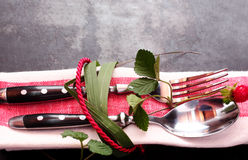 Decorative place setting tied with leaves and rope Royalty Free Stock Photo