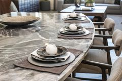Decorative Place Settings On Counter Bar. Decorative Place Settings On Marble Counter Bar In Modern Home Stock Image