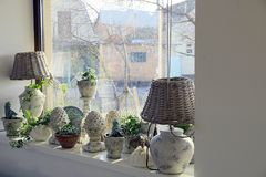 Vases and lamps on the windowsill in the room Stock Image