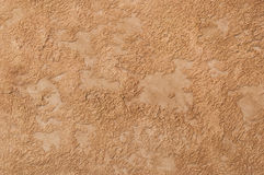 Decorative plaster. Beautiful decorative plaster brown pattern Royalty Free Stock Image