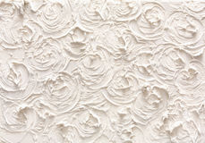 Decorative plaster texture, flower pattern. Relief background, creative stucco surface. Interior design backdrop, construction concept Stock Images