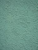 Decorative plaster .Texture and green background stock photography