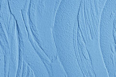 Decorative plaster. Wall stucco texture. In style waves, blue color. Stock Photos