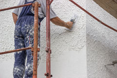 Decorative plaster. White cement based decorative top coat plaster resistant on outside whether conditions. Applied on the surface by a steel trowel. Selective Stock Image