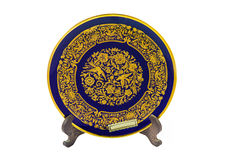 Decorative plate. Decorative gold plate on white background Royalty Free Stock Image
