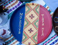 On a decorative plate bears the flag of Moldova and ornament. Stock Photo