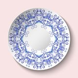 Decorative plate with blue floral ornament in a circle. Empty space in the center. The ethnic style of painting on porcelain. Vector illustration stock illustration