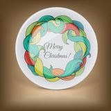 Decorative plate with Christmas wreath Royalty Free Stock Images