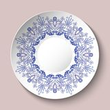 Decorative plate decorated with blue ethnic ornament with hearts in the style of porcelain painting. Vector illustration vector illustration