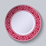Decorative plate with floral painting on the edge of the ethnic oriental style, isolated on gray background. Stock Image