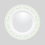 Decorative plate on gray background, top view. Decorative plate with patterned border, on gray background, top view. Vector EPS 10 royalty free illustration