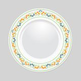 Decorative plate on gray background, top view. Decorative plate with patterned border, on gray background, top view. Vector EPS 10 vector illustration
