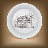 Decorative plate with image of farmhouse. Stock Photos
