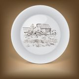 Decorative plate with image of farmhouse. Royalty Free Stock Image
