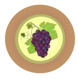 Decorative plate with red grapes  Stock Image