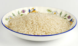 Decorative plate with rice Royalty Free Stock Photos