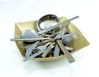 Decorative plate of square form filled with silver table forks, Royalty Free Stock Photography